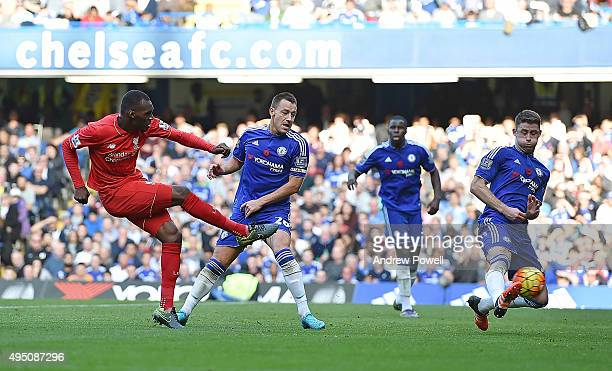 Christian Benteke of Liverpool scores the third goal during the Barclays Premier League match between Chelsea and Liverpool at Stamford Bridge on...