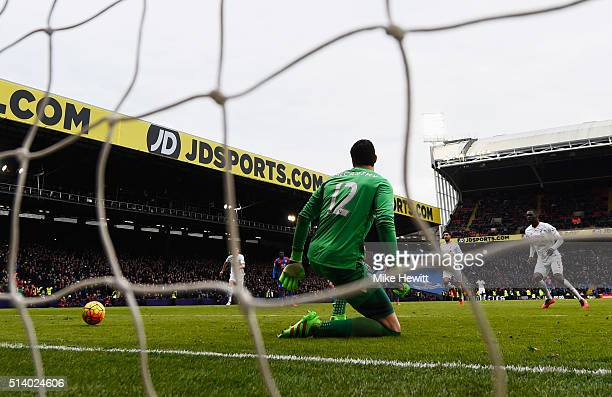 Christian Benteke of Liverpool scores their second goal from the penalty spot past goalkeeper Alex McCarthy of Crystal Palace during the Barclays...