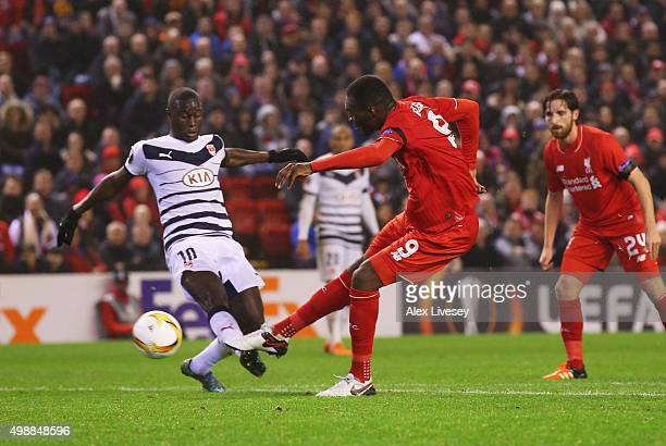 Christian Benteke of Liverpool shoots past Henri Saivet of Bordeaux as he scores their second goal during the UEFA Europa League Group B match...