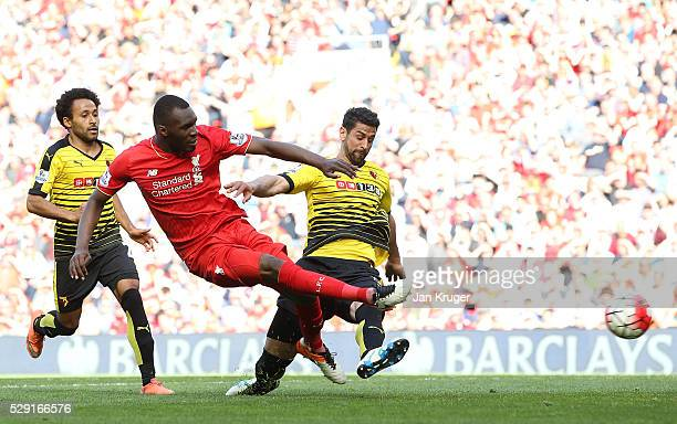 Christian Benteke of Liverpool takes a shot at goal during the Barclays Premier League match between Liverpool and Watford at Anfield on May 8 2016...