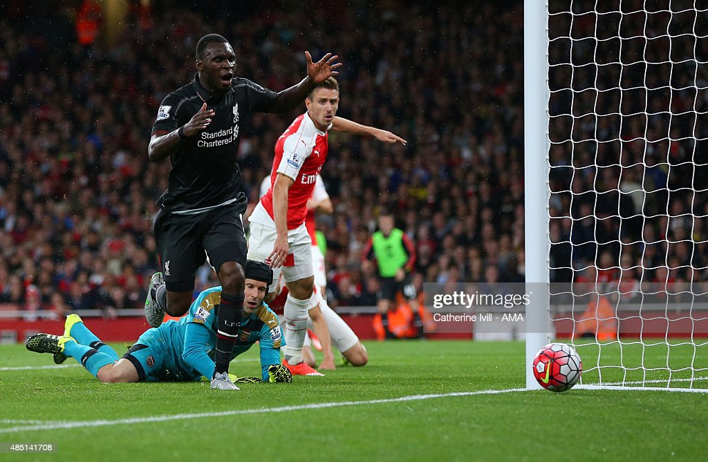 Christian Benteke of Liverpool watches as his shot goes wide of the post after a save from Petr Cech of Arsenal during the Barclays Premier League match between Arsenal and Liverpool at the Emirates Stadium on August 24, 2015 in London, United Kingdom.