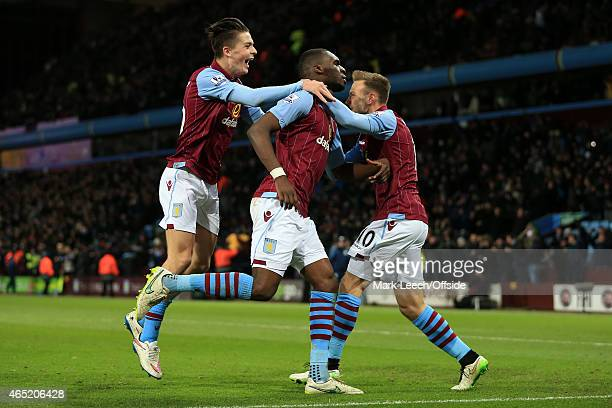 Christian Benteke of Villa celebrates with teammates Jack Grealish and Andreas Weimann after scoring their 2nd goal during the Barclays Premier...