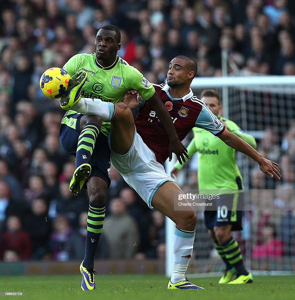 Christian Benteke of Villa is beaten to the ball by Winston Reid of West Ham during the Barclays Premier League match between West Ham United and Aston Villa at Upton Park on November 02, 2013 in London, England.