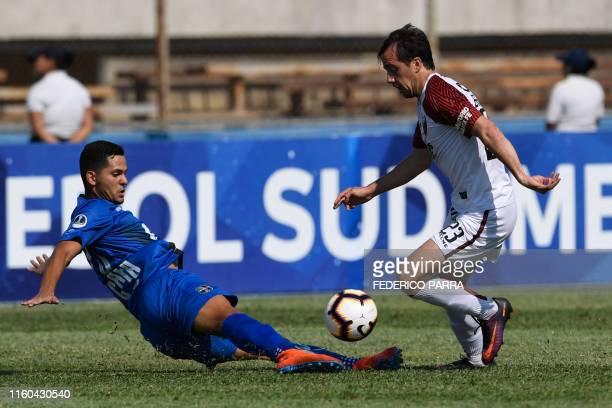 Christian Bernardi of Argentina's Colon dribbles past Andres Maldonado of Venezuela's Zulia during a Copa Sudamericana football match between...