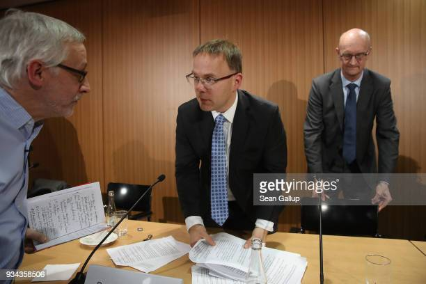 Christian Bex and Frank Pasemann both members of the rightwing Alternative for Germany political party depart after speaking to the media on March 19...