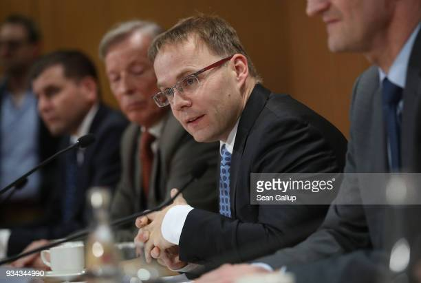Christian Bex and other members of the rightwing Alternative for Germany political party speak to the media on March 19 2018 in Berlin Germany The...