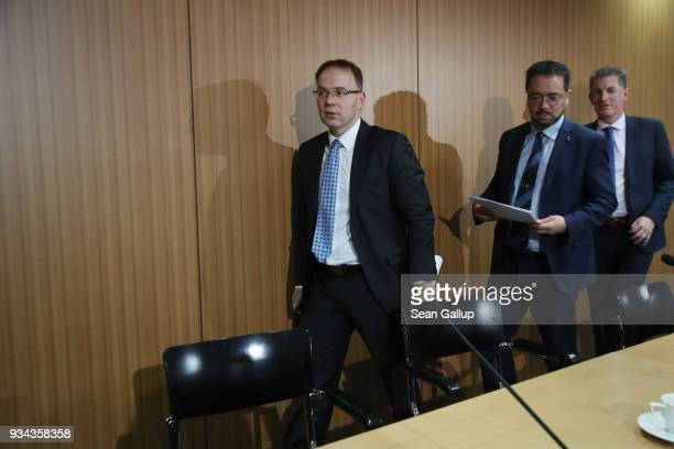 Christian Bex Harald Weyel and Steffen Christ all members of the rightwing Alternative for Germany political party depart after speaking to the media...