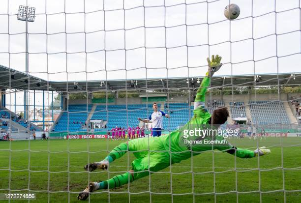 Christian Bickel of Chemnitzer FC misses the last penalty during the penalty shot out past goalkeeper Oliver Baumann of Hoffenheim during the DFB Cup...