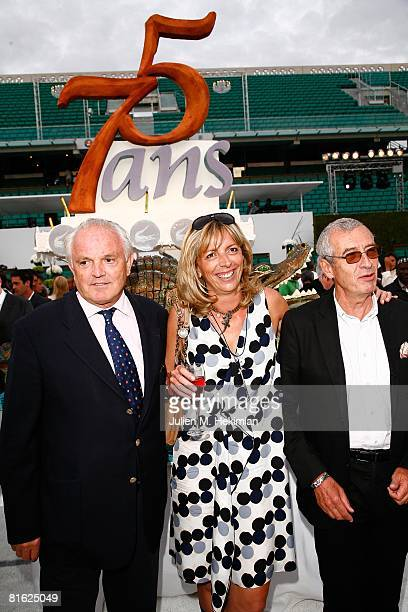 Christian Bime Rejane Lacoste and Michel Lacoste pose next to the birthay cake during the Lacoste 75 years celebration at Roland Garros on June 18...