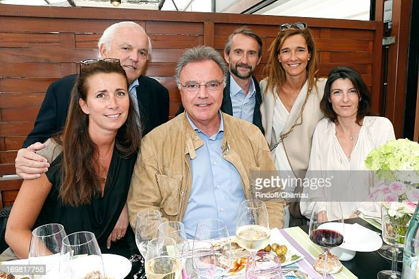 Christian Bimes with his wife Caroline Alain Afflelou and his wife Christine Chief Operating Officer of PSG football team JeanClaude Blanc with his...