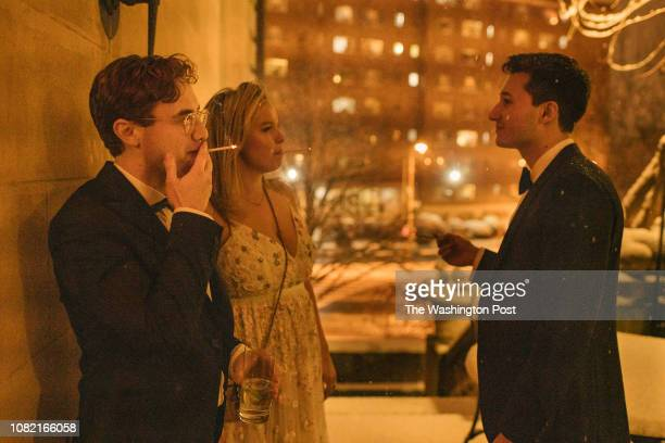 Christian Bishchoff Anna Pouschine and Andrew O'Donohue get some snowy air on the patio during the Russian Ball at a downtown social club in...