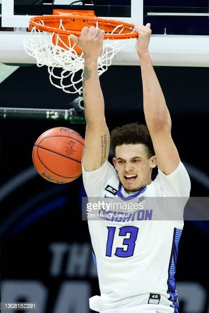 Christian Bishop of the Creighton Bluejays dunks against the UC Santa Barbara Gauchos during the second half in the first round game of the 2021 NCAA...