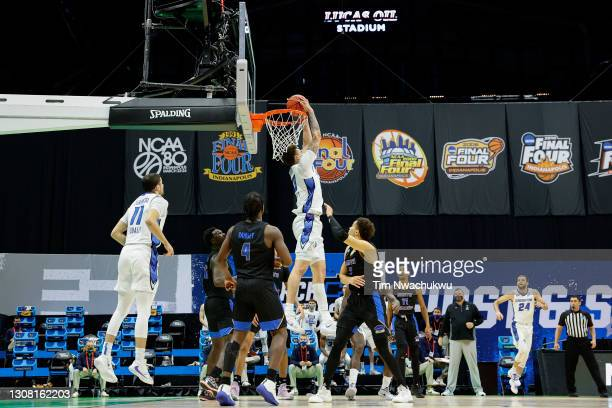 Christian Bishop of the Creighton Bluejays dunks during the second half against the UC Santa Barbara Gauchos in the first round game of the 2021 NCAA...