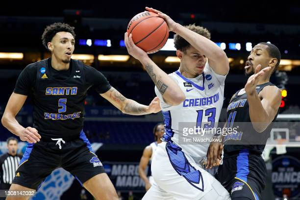 Christian Bishop of the Creighton Bluejays is pressured by Brandon Cyrus of the UC Santa Barbara Gauchos during the first half in the first round...
