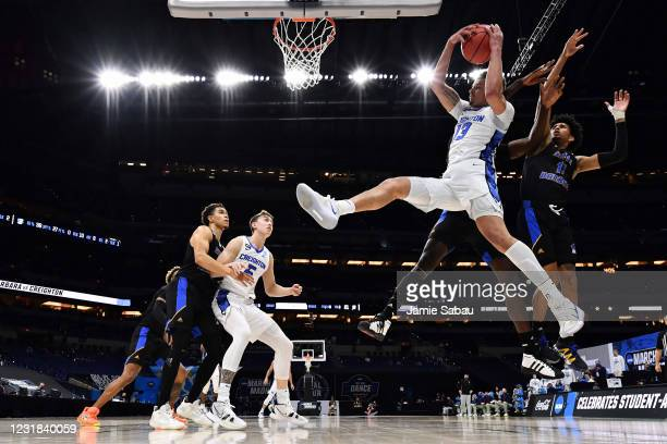 Christian Bishop of the Creighton Bluejays pulls down a rebound in the first half against the UC Santa Barbara Gauchos in the first round of the 2021...