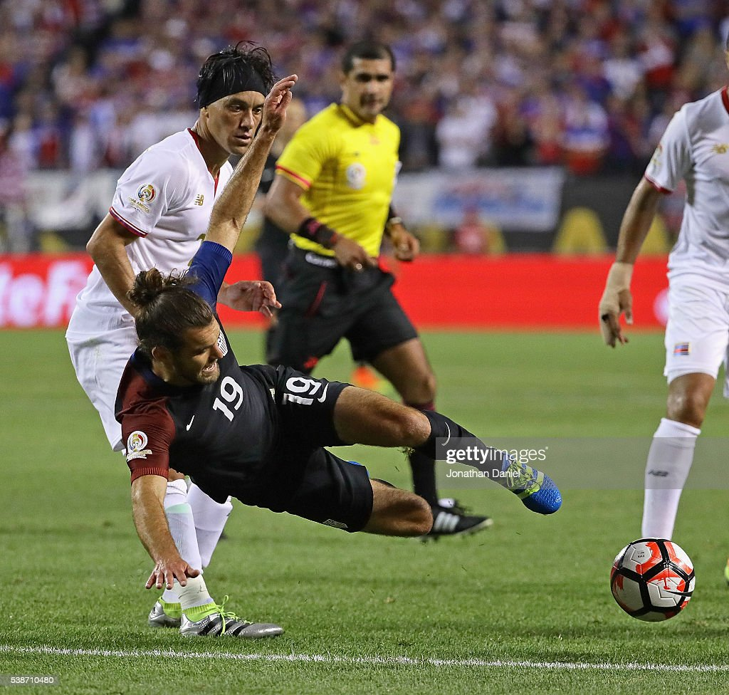 Christian Bolanos #7 of Costa Rica takes down Graham Zusi #19 of the United States during a match in the 2016 Copa America Centenario at Soldier Field on June 7, 2016 in Chicago, Illinois. The United States defeated Costa Rica 4-0.