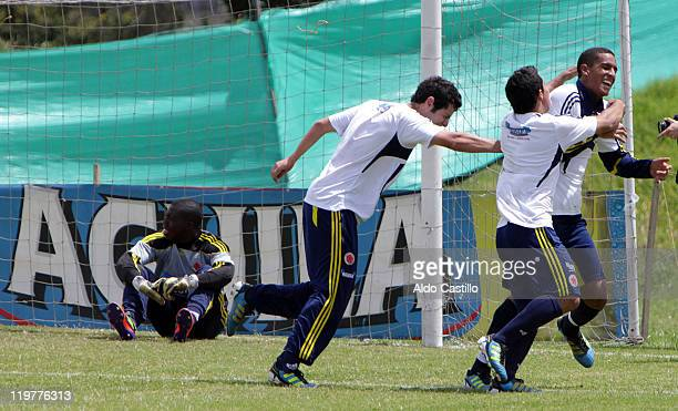 Christian Bonilla celebrates his goal with Michael Ortega behind Jose Adolfo Valencia during a training session prior to the match between Colombia...