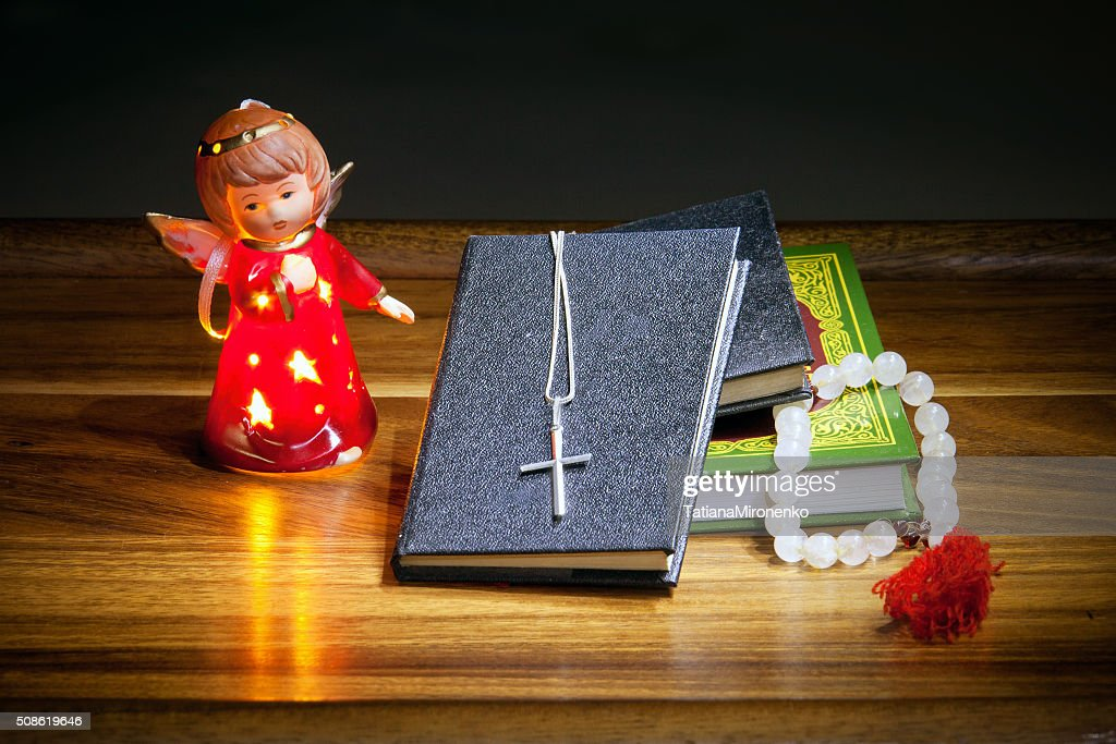 Christian books with  cross, beads and  figure of an angel : Stock Photo