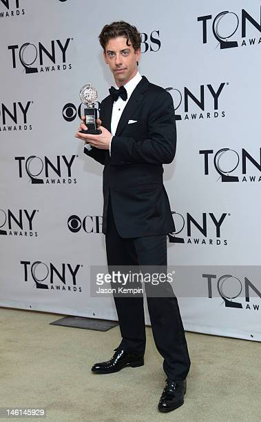 Christian Borle poses in the 66th Annual Tony Awards press room at The Beacon Theatre on June 10 2012 in New York City