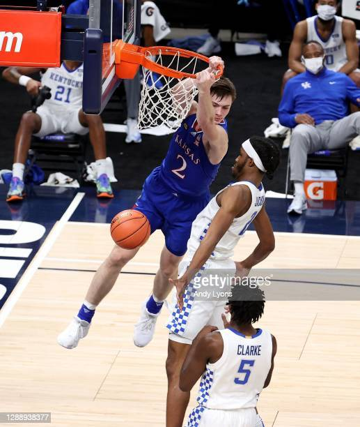 Christian Braun of the Kansas Jayhawks dunks the ball against the Kentucky Wildcats in the State Farm Champions Classic at Bankers Life Fieldhouse on...
