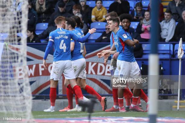 Christian Burgess of Portsmouth FC celebrates with his teammates after scoring his sides first goal of the game during the Sky Bet League 1 match...