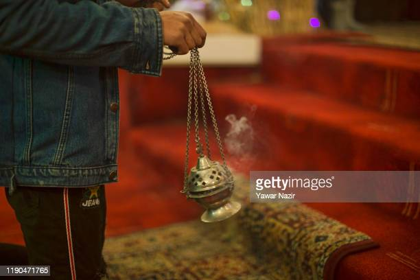 Christian burns incense in the Holy Family Catholic Church during Christmas on December 25, 2019 in Srinagar, the summer capital of Indian-...