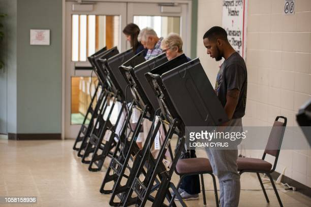 Christian Cantrell an 18 year old casts his vote for the first time in Charlotte North Carolina on November 6 2018 Americans started voting Tuesday...