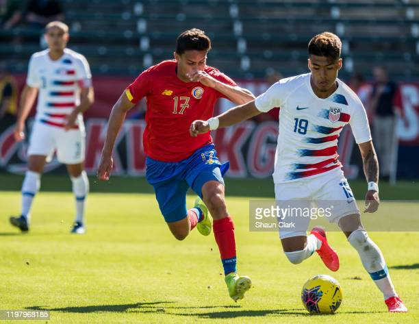 Christian Cappis of the United States battles Yeltsin Tejeda of Costa Rica during the international friendly match between the United States and...