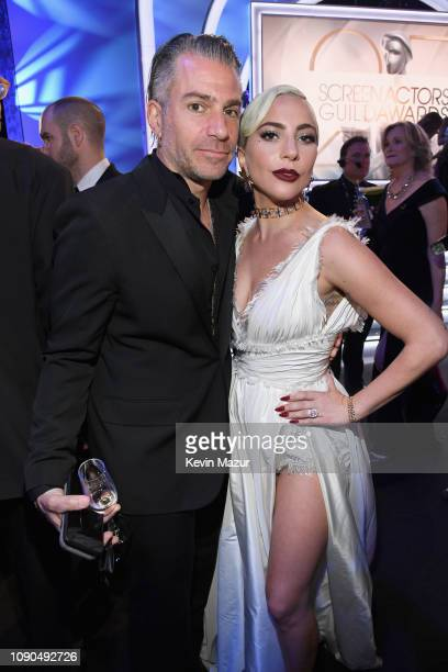 Christian Carino and Lady Gaga attend the 25th Annual Screen Actors Guild Awards at The Shrine Auditorium on January 27 2019 in Los Angeles...