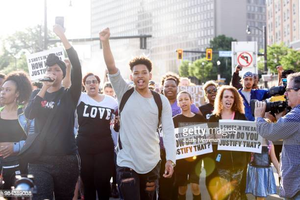 Christian Carter of East Liberty Pennsylvania leads protesters a day after the funeral of Antwon Rose II on June 26 2018 in Pittsburgh Pennsylvania...