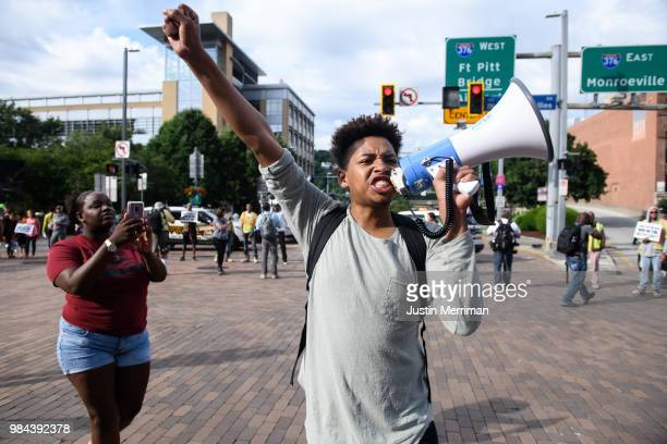 Christian Carter of East Liberty Pennsylvania leads protesters as they block a major downtown intersection a day after the funeral of Antwon Rose II...
