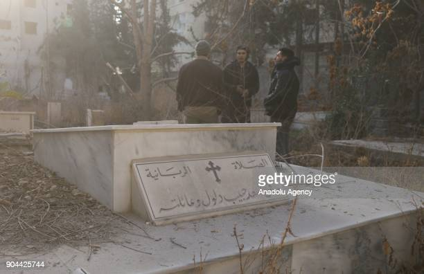 Christian cemetery is seen after looted by Assad Regime's soldiers to find valuables in Harasta district of Damascus Syria on January 12 2018