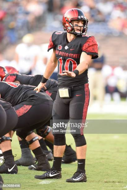 SDSU Christian Chapman directs the offense during the college football game between UC Davis Aggies and San Diego State University Aztecs on...