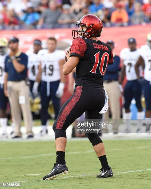 SDSU Christian Chapman drops back to pass during the college football game between UC Davis Aggies and San Diego State University Aztecs on September...