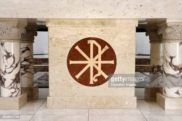 Christian Chi Rho symbol for first two Greek letters of Christ inlaid on the marble altar of a Roman Catholic church in Toronto