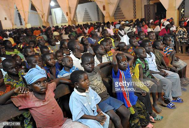 Christian children attend a mass on March 5 2014 led by Bangui's Archbishop Dieudonne Nzapalainga at Bossangoa's Catholic church where several...