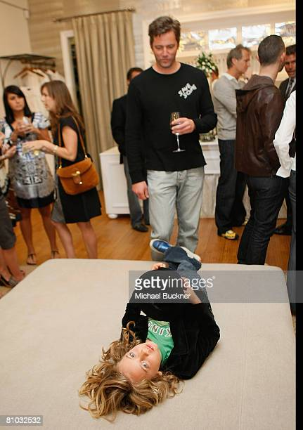 Christian 'Chip' McCaw and son Auden attend Elyse Walker's Silver Party hosted by Valletta on May 8 2008 in Pacific Palisades California