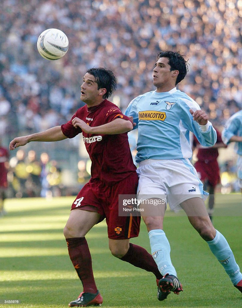 Christian Chivu (L) and Bernado Corradi tussle during the Serie A match between Roma and Lazio on April 21, 2004 in Rome Italy. The match ended in a 1-1 draw. (Photo by Newpress/Getty Images).