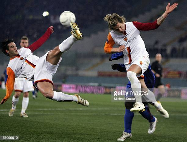 Christian Chivu clears acrobatically from Phillipe Mexes and Jimmy Floyd Hasselbaink of Middlesbrough during the UEFA Cup last sixteen 2nd leg match...