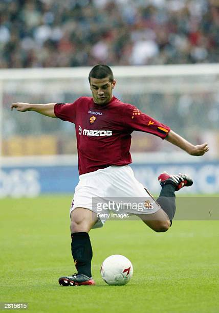 Christian Chivu of Roma kicks the ball during the Serie A match between Roma and Parma at the Alberto Olympic Stadium October 19 2003 in Rome Italy