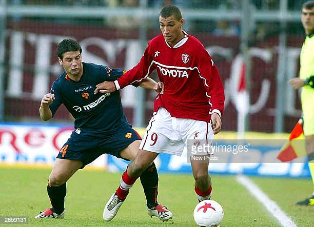 Christian Chivu of Roma tackles Jay Bothroyd of Perugia during the Serie A match between Perugia and Roma at the Renato Curi Stadium on January 11,...