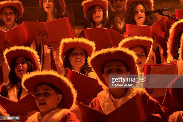 A Christian choir wearing cowboy hats sing during Christmas Eve celebrations on December 24 in the Ashrafiyeh neighborhood of east Beirut AFP...