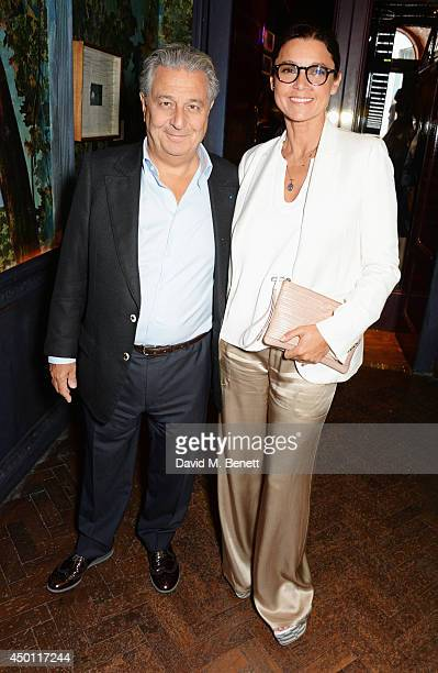 Christian Clavier and Isabelle de Araujo attend a private dinner hosted by Mourad Mazouz Stephen Friedman and David Shrigley to celebrate the...