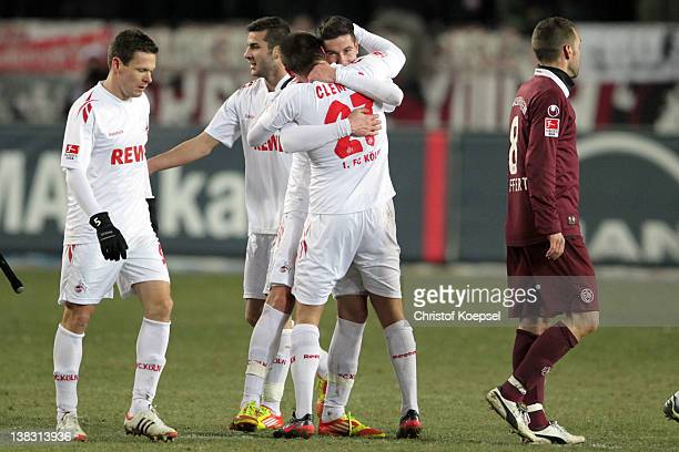 Christian Clemens embraces matchwinner Odise Roshi of Koeln after the Bundesliga match between 1. FC Kaiserslautern and 1. FC Koeln at...