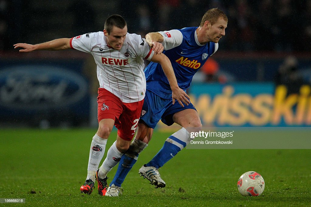 Christian Clemens of Cologne and Lukas Sinkiewicz of Bochum battle for the ball during the Second Bundesliga match between 1. FC Koeln and VfL Bochum at RheinEnergieStadion on November 23, 2012 in Cologne, Germany.