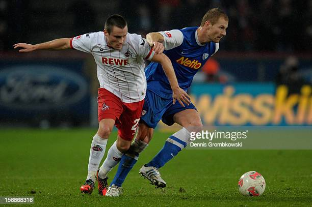 Christian Clemens of Cologne and Lukas Sinkiewicz of Bochum battle for the ball during the Second Bundesliga match between 1 FC Koeln and VfL Bochum...