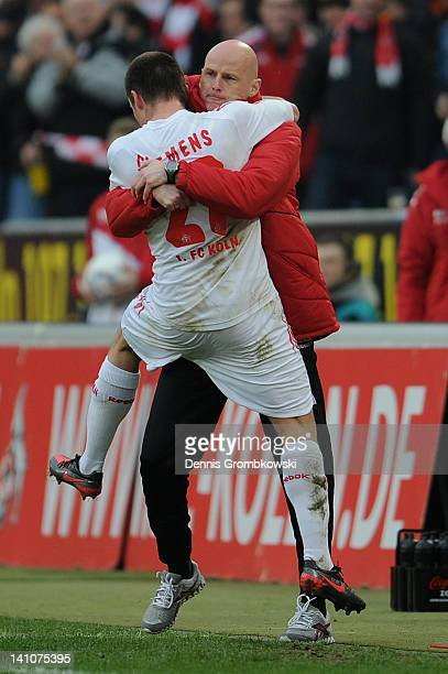 Christian Clemens of Cologne celebrates with head coach Stale Solbakken after scoring his team's first goal during the Bundesliga match between 1. FC...