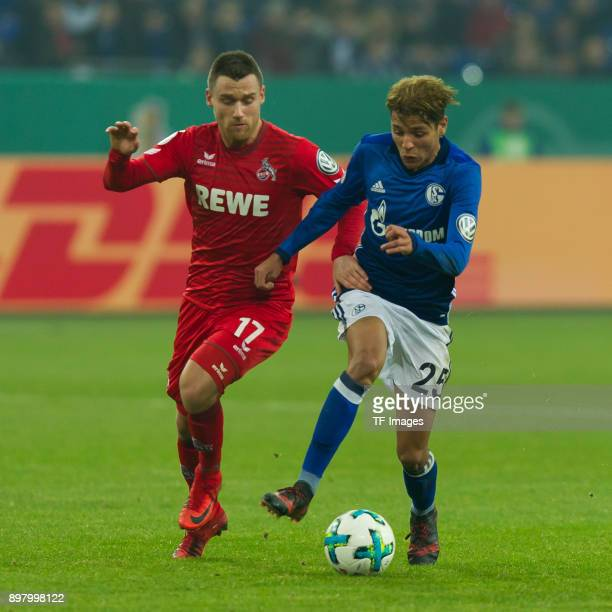 Christian Clemens of Koeln and Amine Harit of Schalke battle for the ball during the DFB Cup match between FC Schalke 04 and 1 FC Koeln at...