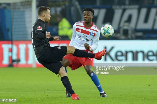 Christian Clemens of Koeln and Gideon Jung of Hamburg battle for the ball during the Bundesliga match between Hamburger SV and 1 FC Koeln at...