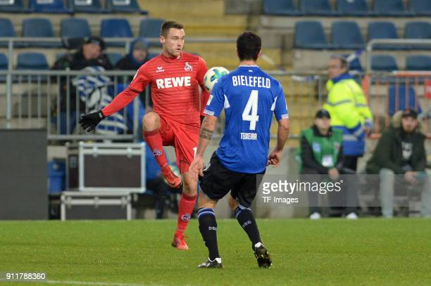 Christian Clemens of Koeln and Nils Teixeira of Bielefeld battle for the ball during the HHotelscom Wintercup match between Arminia Bielefeld and 1FC...